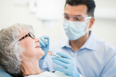 Older woman getting a dental exam